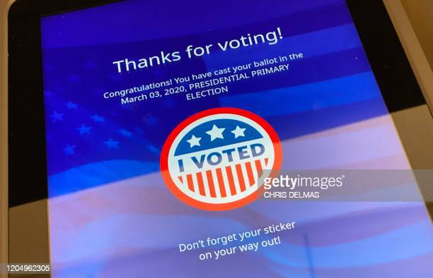 A screen shows a confirmation message after a voter cast their ballot in the California presidential primary in Los Angeles on Super Tuesday March 3...