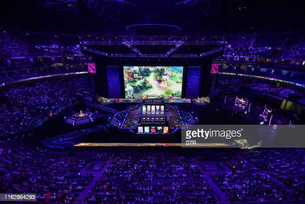 A screen shows a live image of the Dota 2 eSports match between team Alliance and team RNG during the International Dota 2 Championships in Shanghai...