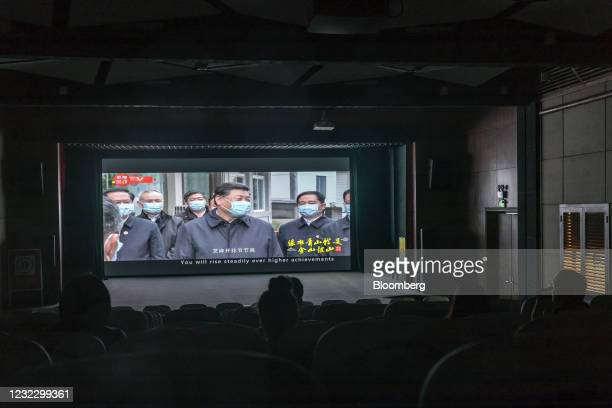 Screen shows a video, featuring Chinese President Xi Jinping during a visit to the region in March, inside an exhibition hall at Yucun Village, Anji...