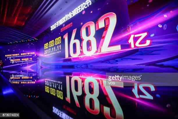 A screen shows Alibaba's GMV exceeding RMB 1682 billion in the Single's Day Global Shopping Festival at Shanghai Expo Centre on November 12 2017 in...