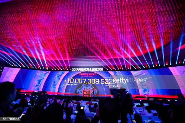 A screen shows Alibaba's sales volume exceeding 10 billion yuan after three minutes and one second at Shanghai Expo Centre during Alibaba Group's...