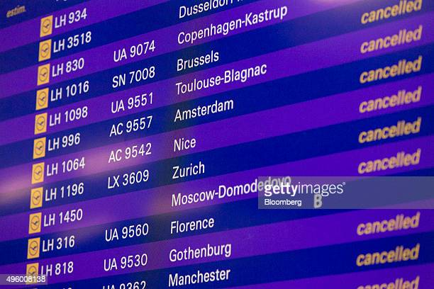 A screen shows cancelled Deutsche Lufthansa AG flights during a Lufthansa cabin crew workers' strike at Frankfurt Airport operated by Fraport AG in...