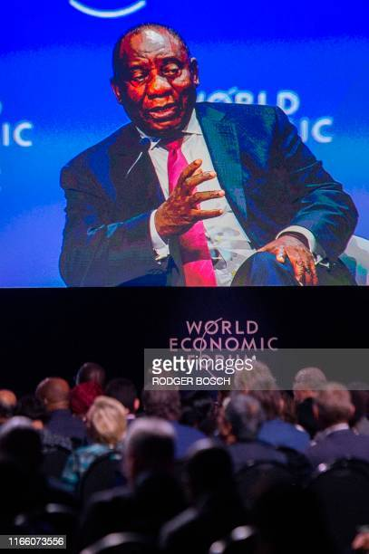 Screen shows Cyril Ramaphosa, South African President, speaking at the World Economic Forum Africa meeting at the Cape Town International Convention...