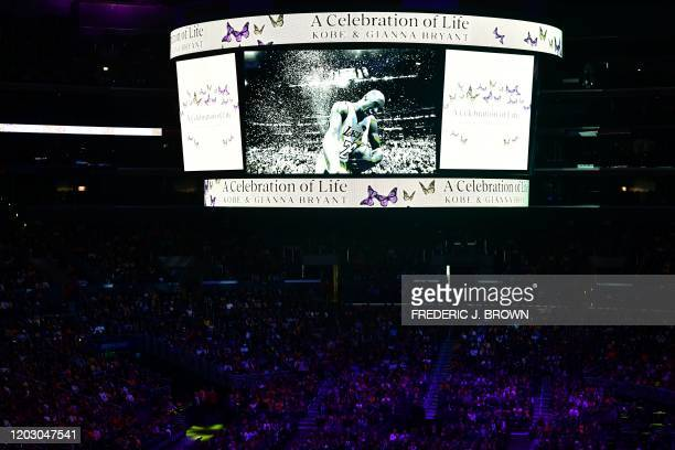 TOPSHOT A screen shows photos during the Celebration of Life for Kobe and Gianna Bryant service at Staples Center in Downtown Los Angeles on February...
