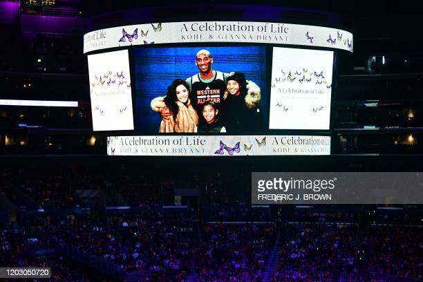 A screen shows photos during the Celebration of Life for Kobe and Gianna Bryant service at Staples Center in Downtown Los Angeles on February 24 2020...