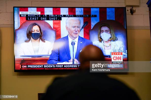 Screen shows President Joe Bidens address of the Joint Session of the 117th Congress on the eve of his 100th day in office, at the U.S. Capitol...