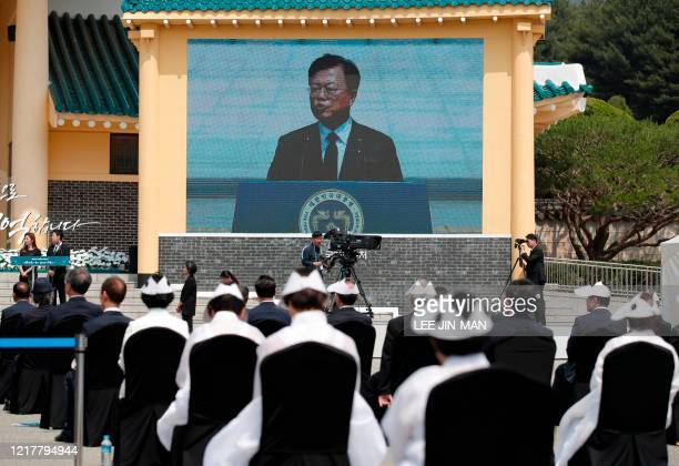 A screen shows South Korean President Moon Jaein speaking during a Memorial Day ceremony at the national cemetery in Daejeon on June 6 2020