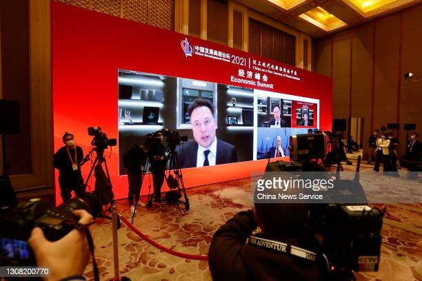 Screen shows Tesla CEO Elon Mask speaking via video link during the 2021 China Development Forum at Diaoyutai State Guesthouse on March 20, 2021 in...