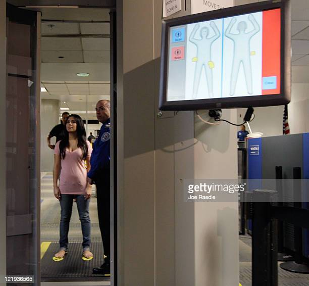 A screen shows the new Automated Target Recognition software as a TSA employee who couldn't provide her name waits to walk into the advanced imaging...