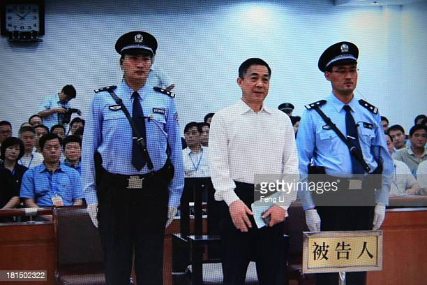 A screen shows the picture of the sentence of Chinese politician Bo Xilai on September 22 2013 in Beijing China The Jinan Intermediate People's Court...