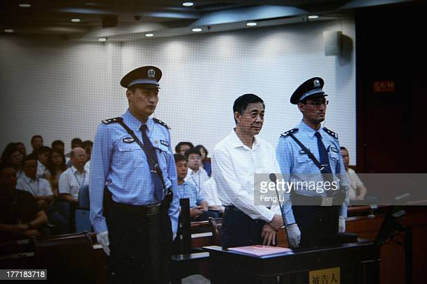 A screen shows the picture of the trial of disgraced Chinese politician Bo Xilai before a press conference in Jihua Hotel on August 22 2013 in Jinan...