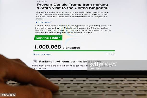 A screen shows the rising number of signatures on a petition calling for President Trump's State visit to be cancelled on January 30 2017 in London...