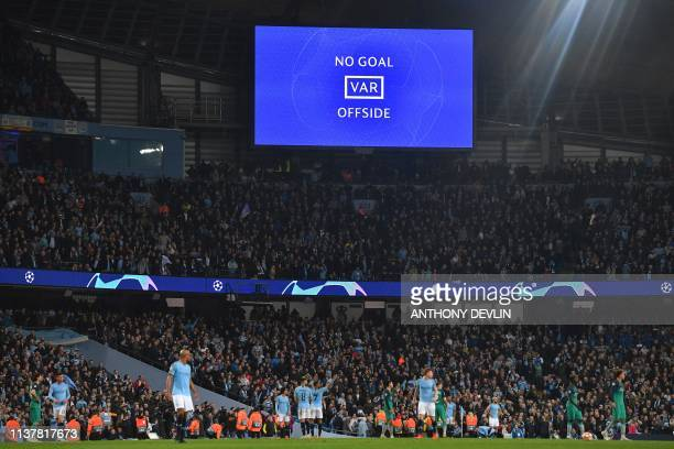 TOPSHOT A screen shows the VAR decision announcing that Manchester City's English midfielder Raheem Sterling's goal has been dissallowed in the...