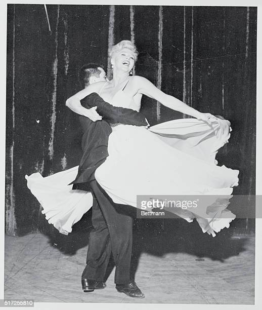 Screen star Ginger Rogers glides through an intricate dance routine during a 1958 nightclub appearance in Las Vegas Mark Alden accompanies the star...