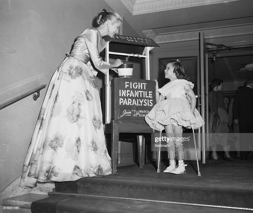 Grace Kelly Talking With Young March of Dimes Representative : News Photo