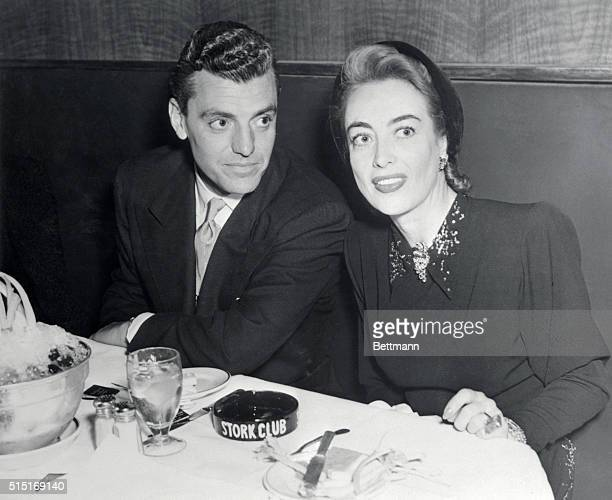 Screen star Joan Crawford is shown at the Stork Club with Greg Bautzer They have been seen together frequently and there are rumors that Bautzer may...