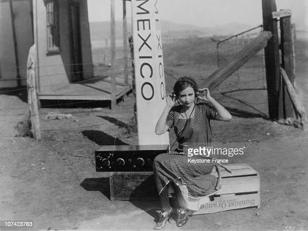 Screen Star Listening The Latest Radio News From The States In Mexico On 1935