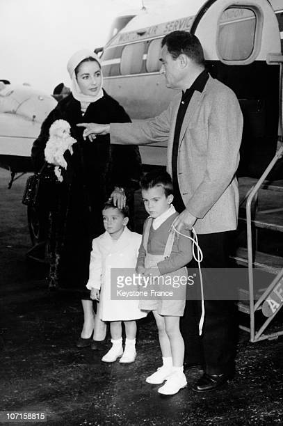 Screen star Liz Taylor with Mike Todd and her two children beside their private airplane on April 23 1957 in Nice France