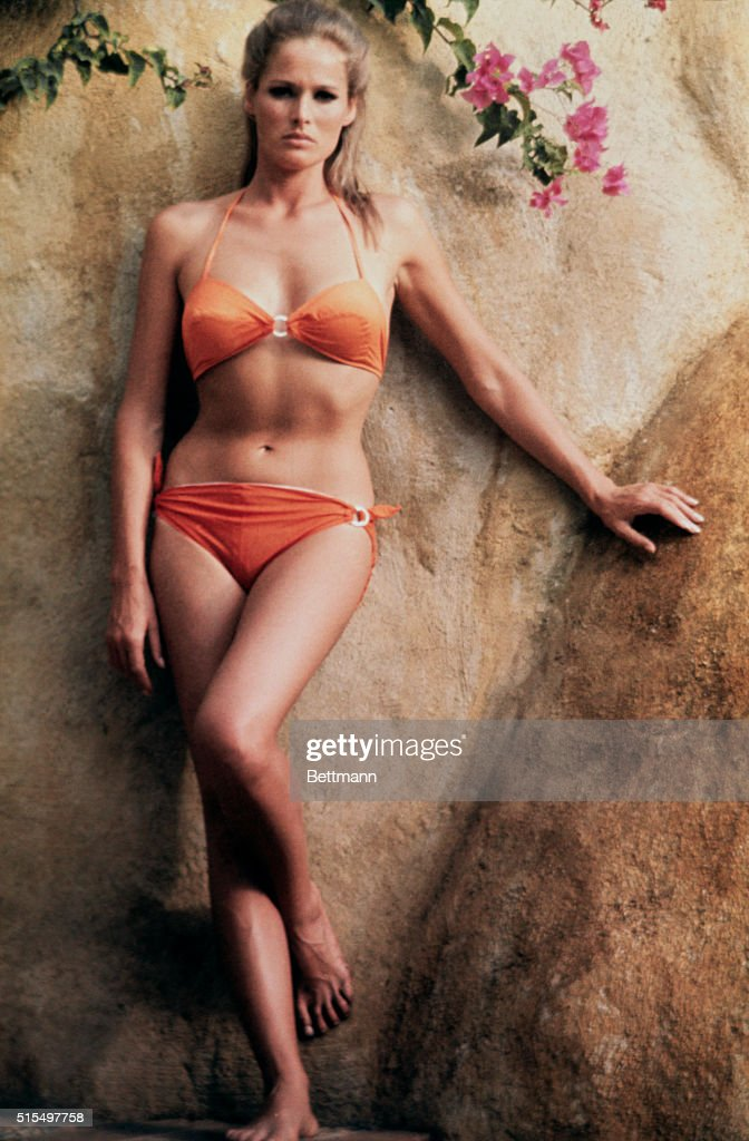 Screen star Ursula Andress in two-piece bathing suit.