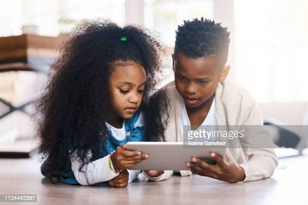 screen time is an inescapable reality of modern childhood - children only stock pictures, royalty-free photos & images