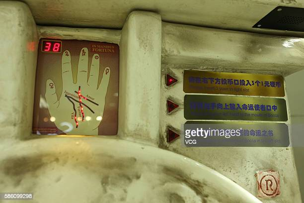 Screen to put hand and step guidance are seen as parts of a fortunetelling machine at an underground mall in People's Square on August 4 2016 in...
