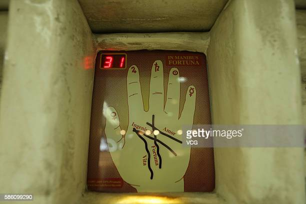 Screen to put hand is seen as part of a fortunetelling machine at an underground mall in People's Square on August 4 2016 in Shanghai China Only...