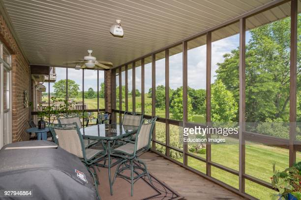 Screened porch of middle-class American home in Kentucky.