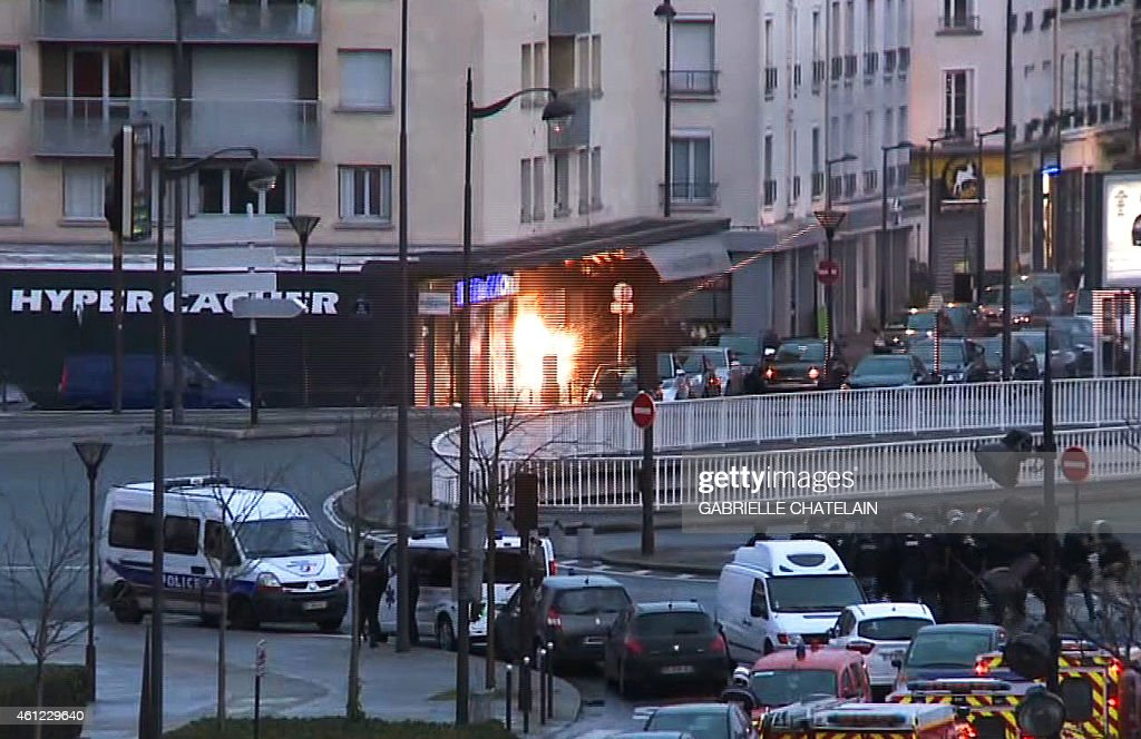 A screengrab taken from an AFP TV video shows a general view of members of the French police special forces launching the assault at a kosher grocery store in Porte de Vincennes, eastern Paris, on January 9, 2015 where at least two people were shot dead on January 9 during a hostage-taking drama at a Jewish supermarket in eastern Paris, and five people were being held, official sources told AFP. Several hostages were freed after French commandos stormed a Jewish supermarket in eastern Paris where an assailant was holed up on January 9. After several explosions, police stormed the shop in Portes de Vincennes and everal hostages exited the store shortly afterwards and were taken to safety.