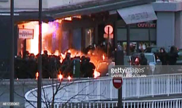 A screengrab taken from an AFP TV video shows members of the French police special forces launching the assault at the Hyper Cacher Kosher grocery...