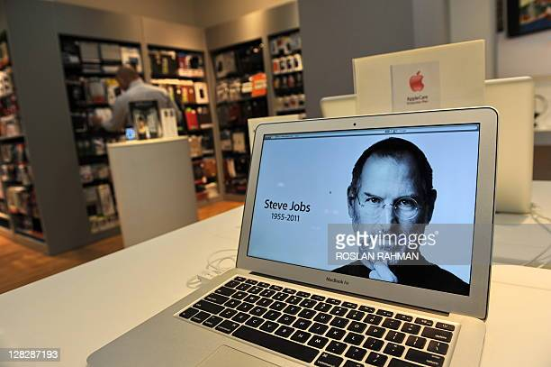 A screens announces the passing of Apple's cofounder and former chief executive Steve Jobs at an Apple reseller store in Singapore on October 6 2011...