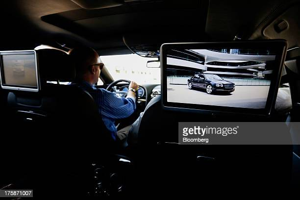 10' LCD screens are seen in the back of the headrests on the Bentley Motors Ltd Flying Spur luxury sedan in Los Angeles California US on Thursday...