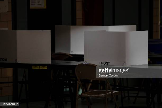 Screens are set up on a table where voters can fill in their choice in the Democratic presidential primary elections at the Taylor Elementary School...