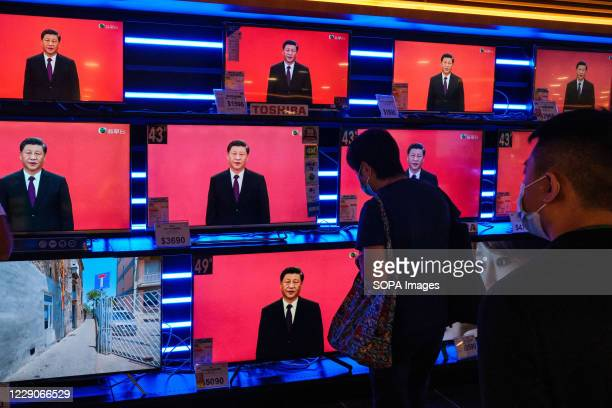 Screens at a department store are seen showing a news broadcast of Chinese President Xi Jinping delivering a speech in Shenzhen. President Xi says...