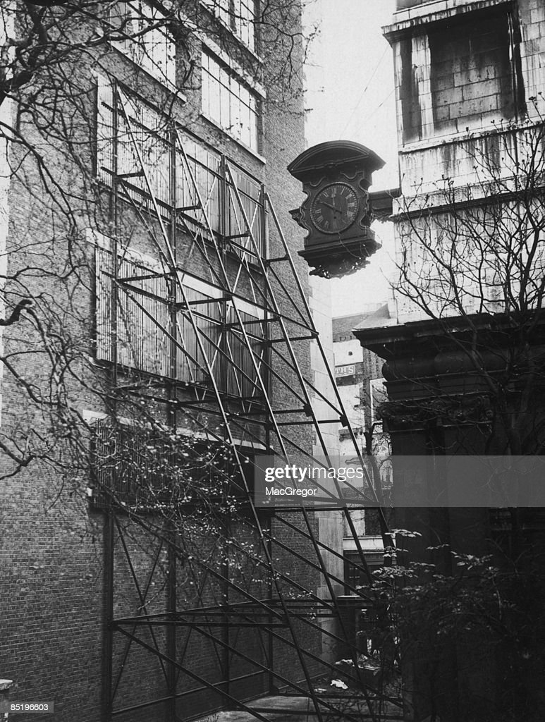Screens blacking out some of the office windows of Adelaide House, next to The Anglican church of St Magnus-the-Martyr, during a legal dispute over 'ancient lights', 14th May 1929. The original building on Lower Thames Street in the the City of London, was destroyed in the the Great Fire of London in 1666, and was rebuilt to a design by Sir Christopher Wren over the subsequent decade.