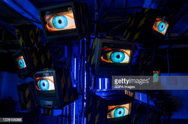Screens display human eyes at one of the attractions from the Cyberpunk exhibition in Hong Kong. Cyberpunk exhibition displays from the inspiration...