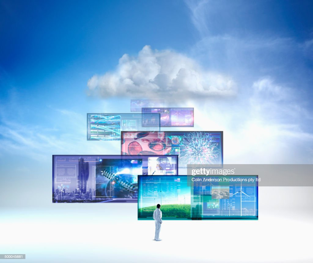 Screens floating in blue sky : Stock Photo