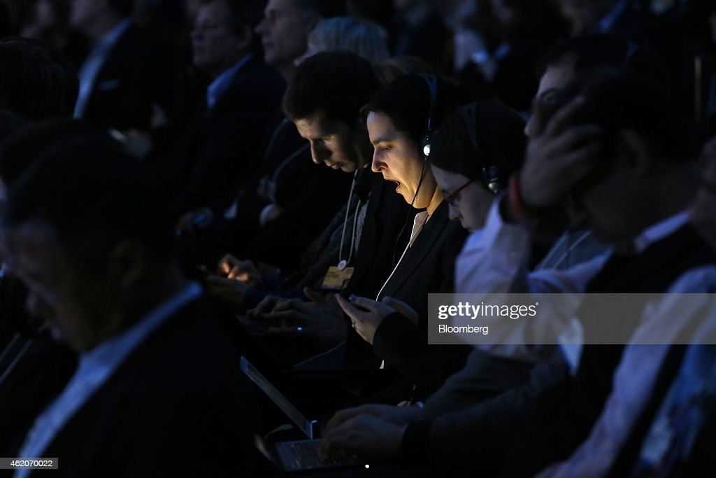 Screens from mobile devices illuminate the faces of attendees as they sit in the audience of a session on the final day the World Economic Forum (WEF) in Davos, Switzerland, on Saturday, Jan. 24, 2015. World leaders, influential executives, bankers and policy makers attend the 45th annual meeting of the World Economic Forum in Davos from Jan. 21-24. Photographer: Jason Alden/Bloomberg via Getty Images