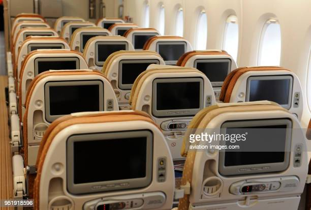 IFE screens in the back of empty economyclass acbin seats in a Singapore Airlines Airbus A380 on flightnumber SQ317 LHRSIN