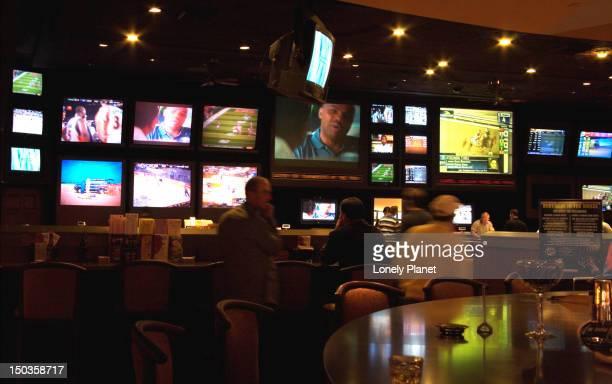 TV screens inside the Sports Bar, Caesars Palace Casino.