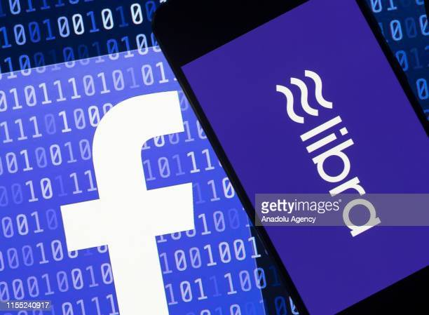 Screens of a smart phone and a laptop display the logos of Libra and Facebook in Ankara Turkey on July 12 2019