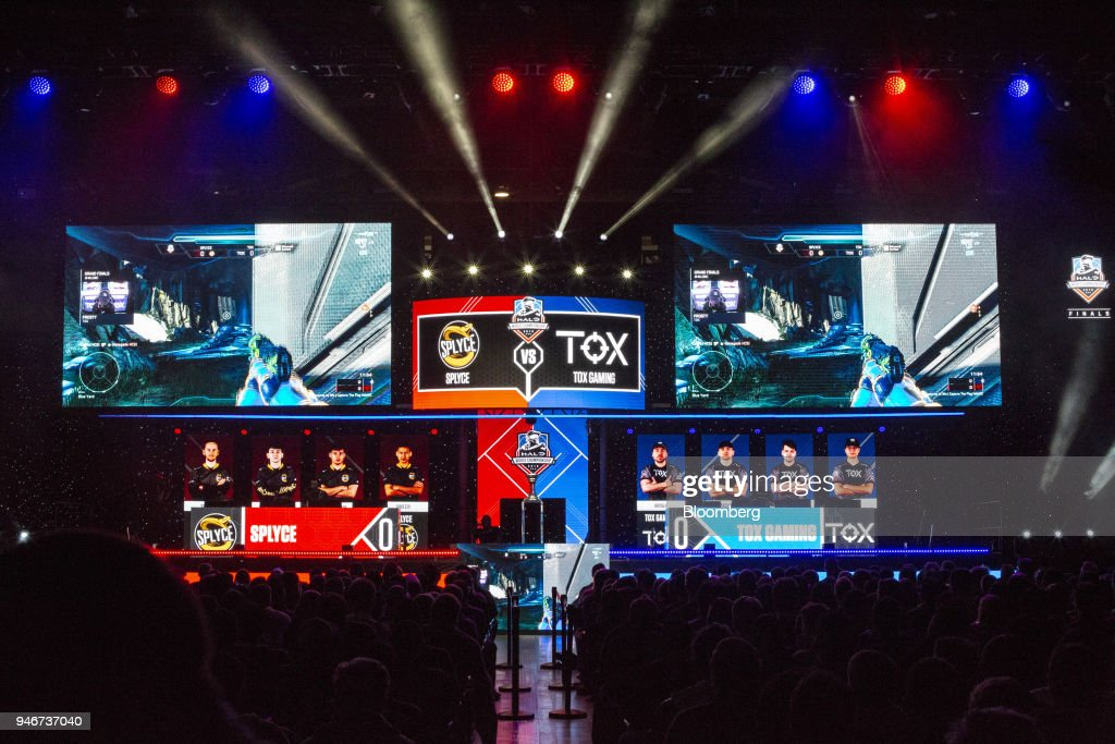 Screens showing game action are displayed on stage during the grand final game between teams Tox and Splyce at the Halo World Championship finals in Seattle, Washington, U.S., on Sunday, April 15, 2018. E-sports revenue, consisting of merchandise, event tickets, sponsorships, advertising and media rights -- all beyond game sales -- is expected to rise at a 32.2% average annual rate in 2016-20 to $1.5 billion in 2020, according to Newzoo. Photographer: David Ryder/Bloomberg via Getty Images