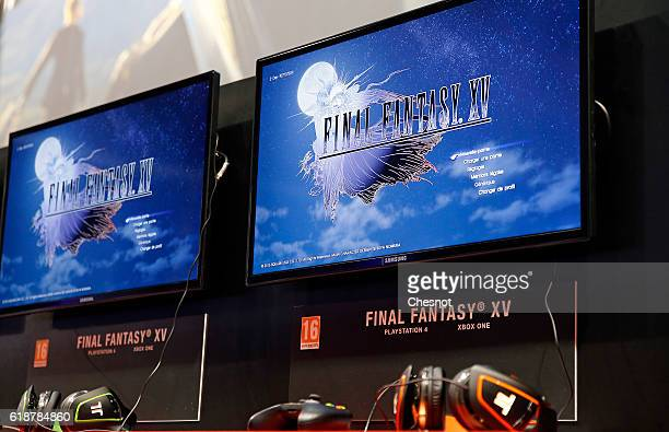 Screens with the video game 'Final Fantasy XV' developed and published by Square Enix are seen during the 'Paris Games Week' on October 28 2016 in...