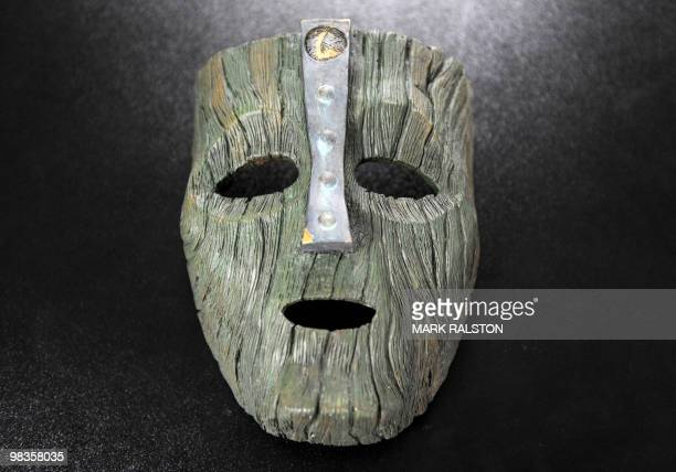 """Screen-worn prop mask of Loki, the Norse God of Mischief from the Jim Carey movie """"The Mask"""" is displayed with other movie memorabilia at the..."""