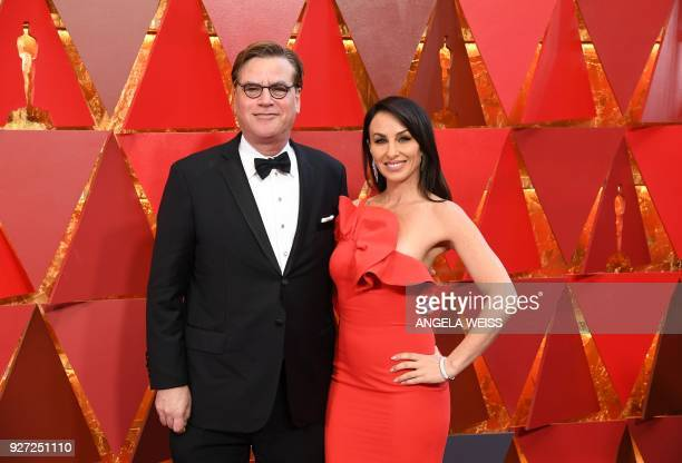 US screenwriter Aaron Sorkin and guest arrive for the 90th Annual Academy Awards on March 4 in Hollywood California / AFP PHOTO / ANGELA WEISS
