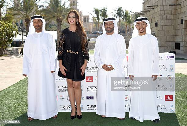 Screenwriter Ahmed Salmeen actress Reem Erhama director Waleed Al Shehhi and actor Abrahim Al Mansoori attend the 'Dolphins' photocall during day...