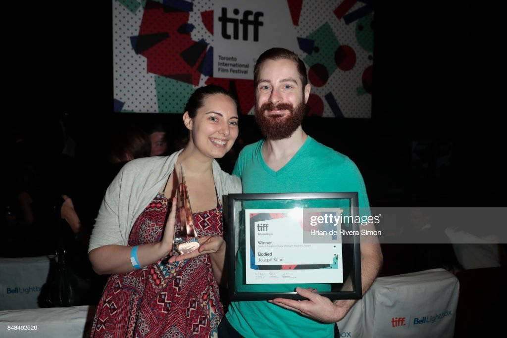 Screenwriter Alex Larsen (R) and guest pose after being awarded with the Midnight Madness Grolsch People's Choice Award for 'Bodied' on behalf of director Joseph Kahn at the 2017 TIFF Awards Ceremony at TIFF Bell Lightbox on September 17, 2017 in Toronto, Canada.