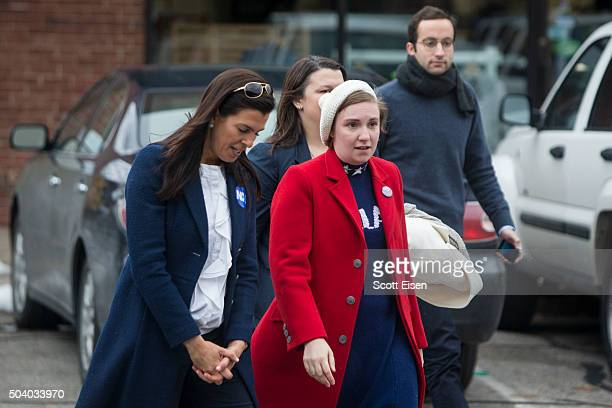Screenwriter and actress Lena Dunham right walks with Portsmouth City Councilor Stefany Shaheen before a Hillary Clinton for President event on...