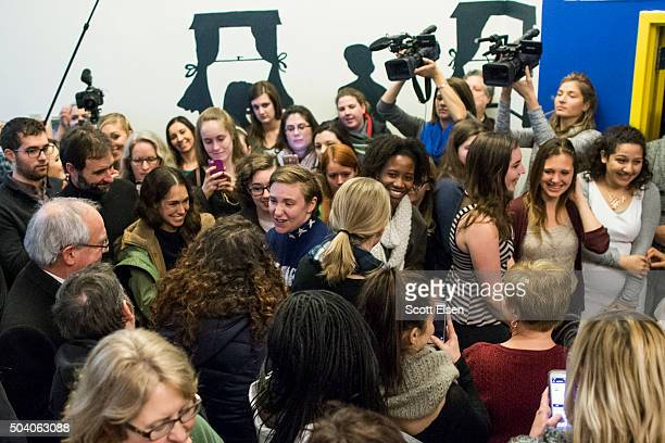 Screenwriter and actress Lena Dunham speaks shakes hands with members of a crowd at a Hillary Clinton campaign office on January 8 2016 in Manchester...