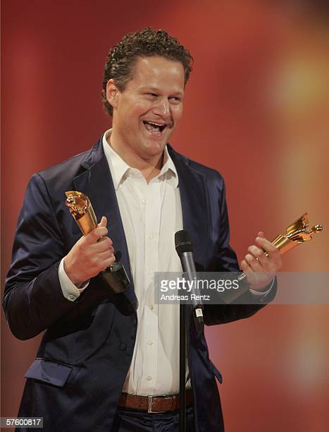 Screenwriter and Director Florian Henckel von Donnersmarck holds his awards at the German Film Awards at the Palais am Funkturm May 12, 2006 in...