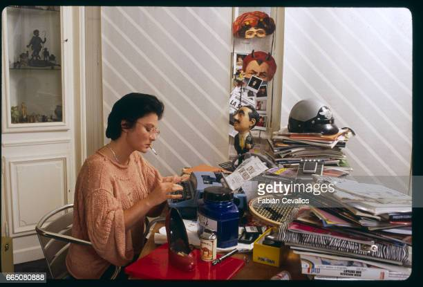 Screenwriter and director Josiane Balasko at home typing in 1984. She was preparing to direct her first feature film, Sac de Noeuds, from her own...